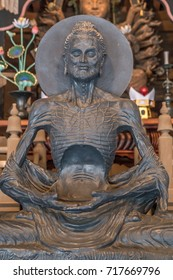 Kamakura, Japan - August 9, 2017 : Fasting Buddha sculpture from Pakistan at Hatto (lecture hall) or Dharma Hall at Kencho-ji temple complex.