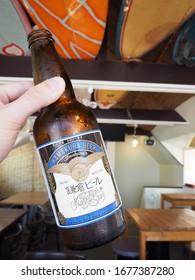 Kamakura, Japan - August 9, 2019: a bottle of Kamakura Star (鎌倉ビール 星), Japanese pale ale beer brewed by Kamakura Beer Brewery (鎌倉ビール醸造), enjoyed on the Yuigahama Beach (由比ガ浜)