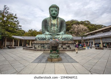 KAMAKURA/ JAPAN - Dec 6, 2019: Kamakura Giant Bronze Buddha statue or or Daibutsu against cloudy sky