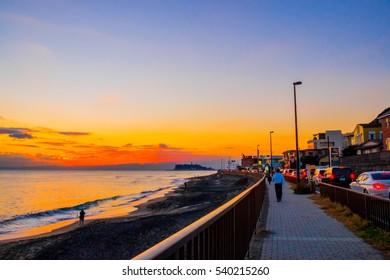 KAMAKURA, JAPAN - DECEMBER 30: Beautiful Sunset view and traffic jam at Kamakura beach, Kanagawa Prefecture Japan