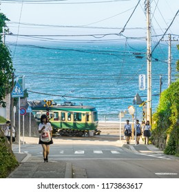 Kamakura, Japan - June 30, 2018:  view of Enoshima electric railway and high school girl walk in kamakura, Japan.