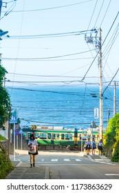 Kamakura, Japan - June 30, 2018:  view of Enoshima electric railway and high school girl walk in kamakura, Japan.