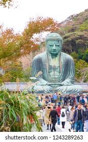 KAMAKURA , JAPAN - NOVEMBER 07, 2018:People visit Kamakura Daibutsu is the famous landmark located at the Kotoku-in temple in Kamakura,Japan