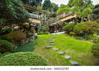 Kamakura, Japan - November 10, 2016: Traditional architecture with oriental garden in Kamakura, Japan. Kamakura is a city in Kanagawa Prefecture of Japan.
