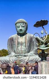 KAMAKURA , JAPAN - NOVEMBER 20, 2015: Scenery of the Great Amida Buddha and tourists in Kamakura. Kamakura Daibutsu is the famous landmark located at the Kotoku-in temple in Kanagawa Prefecture.