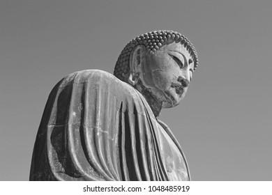 Kamakura, Japan - November 21, 2017 :  The Great Buddha of Kotokuin Temple in Kamakura. View of the Great Buddha bronze statue at Kotoku-in temple in Kamakura against a clear blue sky,
