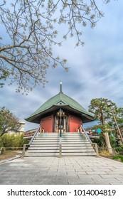 "Kamakura, Japan - November 22, 2017 : Ebisu-do Hall of Hongaku-ji Temple  devoted to Ebisu deity of commerce and fishermen, one of the ""Shichifukujin"" Seven Deities of Good Fortune of Kamakura"