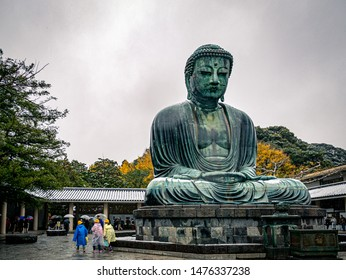 Kamakura, Japan - November 24, 2016: Daibutsu. The Great Buddha of Kotokuin Temple in Kamakura. View of the Great Buddha bronze statue at Kotoku-in temple in Kamakura with snowfall in autumn.