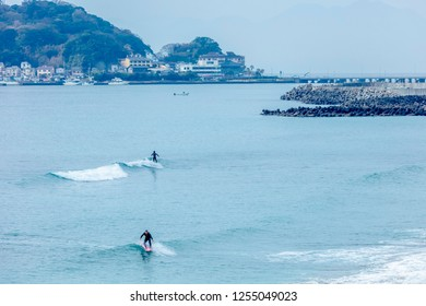 Kamakura, Kanagawa / Japan - December 3 2018: Autumn surfing at Kamakura enoshima Kamakura koko mae beach