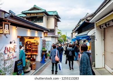 Kamakura, Kanagawa / Japan - December 3 2018: Kamakura Komachi Dori retail shopping street bustling retail area outside JR enoden station