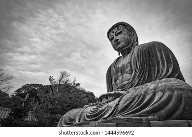 Kamakura, Kanagawa Prefect / Japan – March 23, 2019:  A cloudy day at the Kamakura Daibutsu, the Great Buddha of Kamakura.
