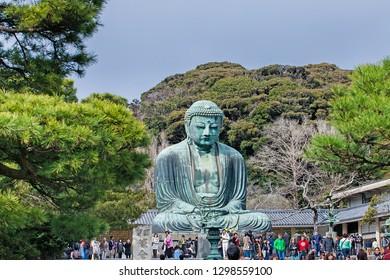 KAMAKURA ,KANAGAWA PREFECTURE ,JAPAN - MARCH 21, 2017 : Scenery of Great buddha and tourist visiting in Kamakura old town,Kamakura Daibutsu is the famous landmark located at the Kotoku-in temple.