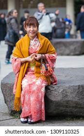 KAMAKURA ,KANAGAWA PREFECTURE ,JAPAN - MARCH 21, 2017 : Beautiful japanese woman in kimono enjoying at Japanese shrine on winter in Kamakura old town, Japan