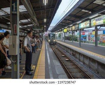 Kamakura/Japan - August 6 2018: Enoden line train arriving in Kamakura station. The Enoshima Electric Railway or Enoden is a private railway in Japan which connects Kamakura with Fujisawa.