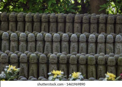 Kamakura/Japan - May 19, 2019: rows of stone Jizo Bodhisattva statues in the Hase-dera temple in Kamakura, Japan. Jizo is special to pregnant women and to those whose children have died.