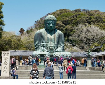 Kamakura,Japan-4.12.2019:Bronze statue of Amida Buddha or Great Buddha,second tallest bronze Buddha statue in Japan on the open grounds of Kotokuin Temple surrounded by forest and many tourists