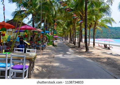 Kamala, Thailand - May 2, 2015: Bars and restaurants on the shady pedestrian footpath along Kamala beach on Phuket island.