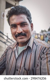 KAMALAPURAM, INDIA - 02 FABRUARY 2015: Indian man on a marketplace close to Hampi. Post-processed with grain, texture and colour effect.