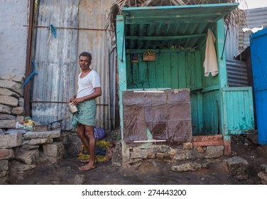 KAMALAPURAM, INDIA - 02 FEBRUARY 2015: Indian man heating coal for iron in a town close to Hampi