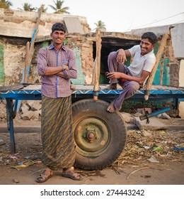 KAMALAPURAM, INDIA - 02 FEBRUARY 2015: Indian men relaxing on trailer
