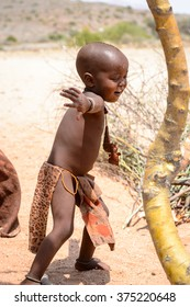 KAMANJAB, NAMIBIA - JAN 8, 2016:: Unidentified little boy  from Himba tribe. The Himba are indigenous people living in northern Namibia and Angola