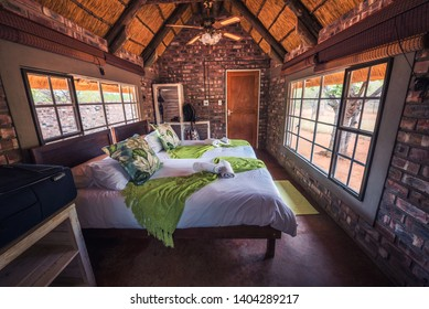 Kamanjab, Namibia - March 30, 2019 : Chalet interior of the Kaoko Bush Lodge in Kamanjab. This desert lodge is located near the Galton Gate of Etosha National Park. Hdr processed.