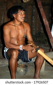KAMAYURA VILLAGE, BRAZIL - MAY 18: Member of a threatened Indian tribe, the Kamayura, playing a sacred flute on May 18, 2008, in the Kamayura village.