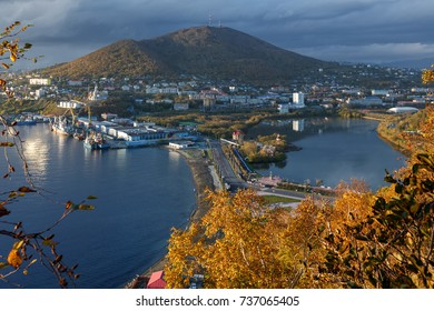 Kamchatka city landscape: autumn view of Petropavlovsk-Kamchatsky City and seaport on shore of Avachinskaya Bay (Avacha Bay) in Pacific Ocean. Kamchatka Region, Russian Far East, Eurasia.