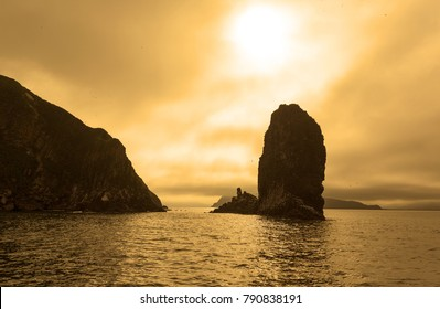 Kamchatka colorful seascape: beautiful view of Rocks in Avachinskaya Bay (Pacific Ocean) at sunset. Kamchatka Peninsula, Russian Far East, Eurasia.