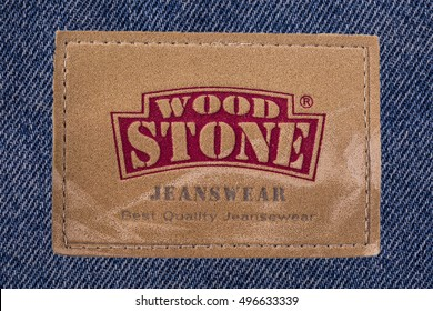Kamchatka - October- 10, 2016: Closeup of WOOD STONE's  leather jeans label isolated on white background.WOOD STONE is a privately held American clothing company.