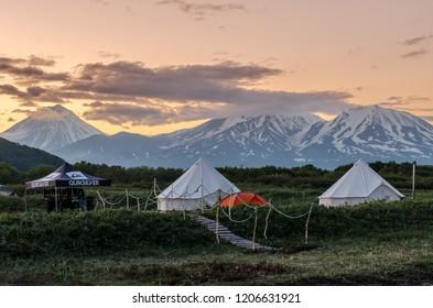 Kamchatka Peninsula / Russia - 07.07.2018: QuickSilver surf school. Tent camp on the Pacific coast