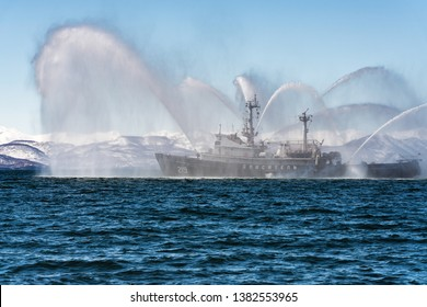 KAMCHATKA PENINSULA, RUSSIA - APR 27, 2019: Rescue and salvage ship of Pacific Fleet of Russia spray water on sea for supporting emergency case of fire of warships, cargo and passenger ships.