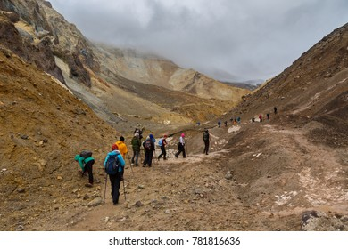 Kamchatka Peninsula, Russia - August 26, 2016: Tourists during the ascent to the active volcano Mutnovsky in Kamchatka.