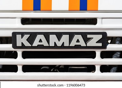 KAMCHATKA PENINSULA, RUSSIA - OCT 2, 2018: Badge of truck KAMAZ and sticker orange-blue stripes of Emercom of Russia on front car cabin. KAMAZ - Russian brand of trucks and engines manufacturer.