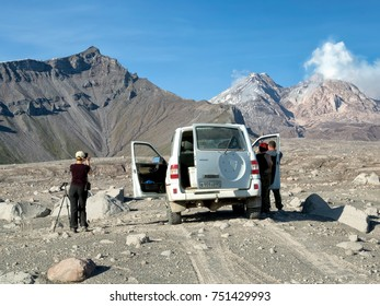 KAMCHATKA PENINSULA, RUSSIA - SEP 8, 2017: The Russian SUV UAZ-PATRIOT with group of tourists at Shiveluch Volcano.(3307m) Active.