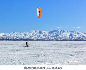 KAMCHATKA PENINSULA, RUSSIAN FAR EAST - MARCH 24, 2018: Kitesurfing on the snow-covered river.