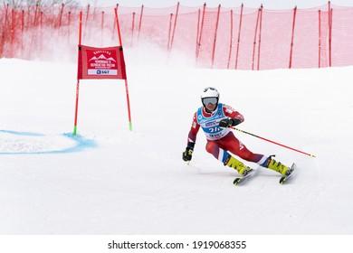KAMCHATKA PENINSULA, RUSSIAN FEDERATION - APRIL 2, 2019: Mountain skier Kravchenko Grigory Sverdlovsk Region skiing down snowy mountain slope. Russian Men's Alpine Skiing Championship, giant slalom.