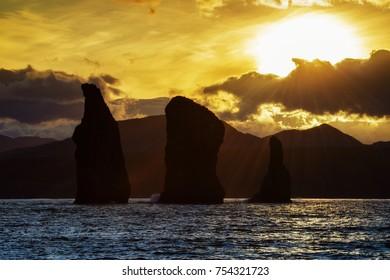 Kamchatka Peninsula scenery seascape at sunset: view of beautiful islands Three Brothers Rocks in Avachinskaya Bay (Avacha Bay). Eurasia, Russian Far East, Kamchatka Region, Pacific Ocean.