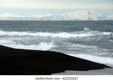 Kamchatka - Petropavlovsk-Kamchatsky - Pacific Ocean bay with ships and mountains with volcanoes.