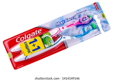 Kamchatka, Russia -May 13, 2019;: Colgate oral brush on white.Colgate is a brand of toothpaste produced by Colgate-Palmolive