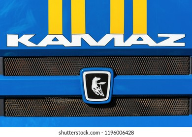 KAMCHATKA, RUSSIA - OCT 2, 2018: Badge and logotype of truck KAMAZ and sticker orange-blue stripes of Emercom of Russia on front car cabin. KAMAZ - Russian brand of engines manufacturer and trucks.