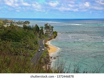 Kamehameha highway curves along the shoreline on the east shore of Oahu, between the mountains & jungle, and the beach & ocean.