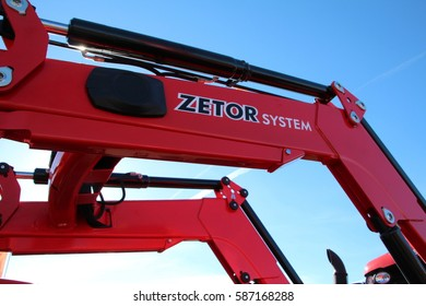 KAMEN, CZECH REPUBLIC - September 10, 2013: Zetor loading system attached to new red Zetor tractor, big machinery, agriculture