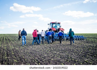 Kamenka, Penza region/Russian Federation- 05/20/2019: Group of farmers watching the test of the new hoe of the beets with new hoe