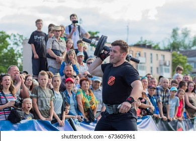 "Kamenskoe, Ukraine - June 10, 2017: Sport festival ""Bogatyrskie Igry"" in Kamenskoe with the support of World's Strongest Man 2004 Vasyl Virastyuk. Strong men challenge, Sports power competitions."