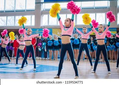 "Kamenskoye, Ukraine - February 18, 2018: Championship KPSK ""Prometheus"" oncheerleading, young cheerleaders perform at the city cheerleading championship"