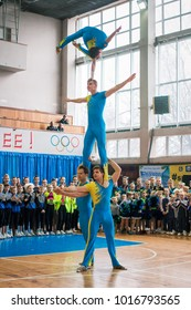Kamenskoye, Ukraine - March 9, 2017: demonstration performances of acrobats at the championship in cheerleading