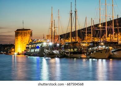 Kamerlengo castle and sailing boats in harbor in Trogir, Croatia. Night scene. Travel destination.
