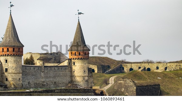 Kamianets Podilskyi fortress built in the 14th century. View of the  fortress wall with towers at early springtime, Ukraine.