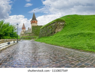 Kamianets-Podilskyi fortress built in the 15th century. Road covered with cobbles to the castle after rain, Khmelnytskyi oblast, Ukraine